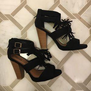 Black suede fringe heels
